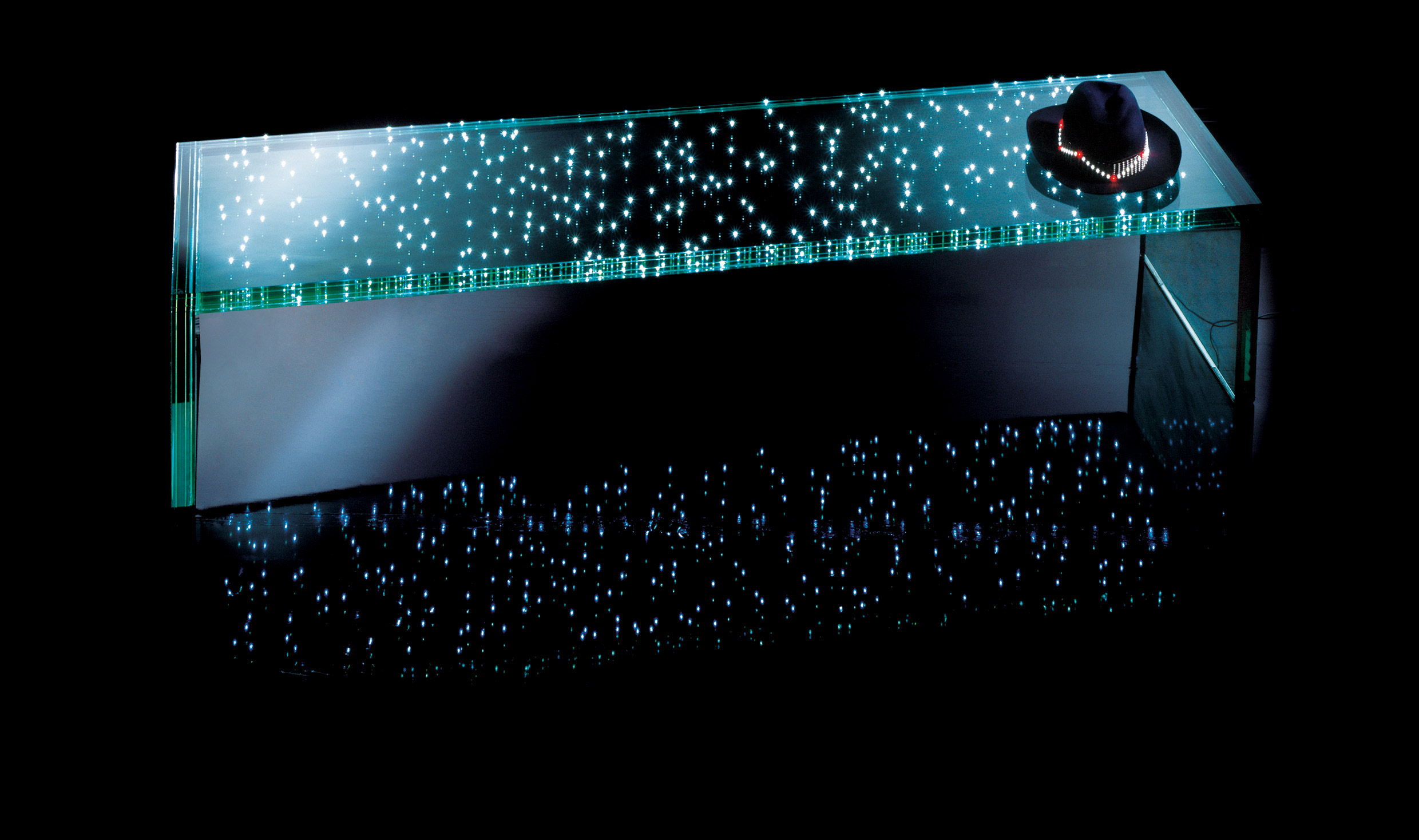 LED Bench by Ingo Maurer - LEDs are magically powered between two pieces of glass