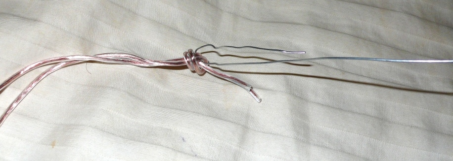 Tie a knot with the LED wire around a hook you form with the stiff steel wire